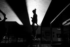 in between (maekke) Tags: zürich hauptbahnhof zürichhauptbahnhof zürichhb silhouette light shadow shadows shadowplay woman highcontrast fujifilm x100f 2019 bw noiretblanc ch switzerland publictransport sbb zvv streetphotography 35mm