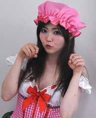 Girl Can Sock (emotiroi auranaut) Tags: girl woman lady model gorgeous beautiful lovely cute angry actress annoyed fists bonnet red white pink