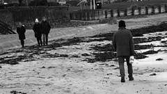 Taking the Milk For a Walk on the Beach (byronv2) Tags: street candid peoplewatching blackandwhite blackwhite bw monochrome northberwick sea northsea coast coastal seaside scotland river rnbforth riverforth forth firthofforth man walking milk milkbottle