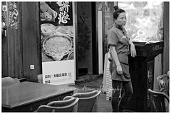 Chinatown, Singapore (~ veronicajwilliams photography ~) Tags: veronicajwilliamsphotography veronicajwilliams copyrighted singapore travelphotography travel travelling traveling fuji fujixt20 fuji18135 fujifilm fujifilmxt20 fujiaustralia fujisingapore chinatown blackandwhite bored boredom restaurant tired weary woman streetphotography