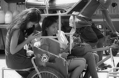 Passengers (Beegee49) Tags: street girls filipina tricycle public transport checking messages blackandwhite monochrome bw luminar sony a6000 silay city philippines asia happyplanet asiafavorites