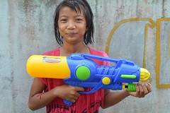 proud to have the biggest water gun (the foreign photographer - ฝรั่งถ่) Tags: wet girl water squirt gun khlong thanon portraits bangkhen bangkok thailand nikon d3200 songkran