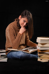 I am reading and you bother me (dim.pagiantzas | photography) Tags: portrait girl woman female face eyes black studio spot lighting colors books reading read study paper jean photography