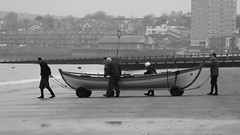 Time to Launch 01 (byronv2) Tags: peoplewatching candid street blackandwhite blackwhite bw monochrome portobello edinburgh edimbourg scotland beach sea northsea river riverforth rnbforth firthofforth forth coast coastal shore boat rowboat skiff sailing rowing water