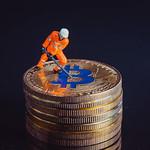 Miner working on a golden Bitcoin thumbnail