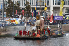 Shipwrecked Giant in Canning Dock, Liverpool waterfront, Merseyside, UK (Ministry) Tags: giantuncle canningdock liverpool waterfront merseyside uk raft lilliputian royaldeluxe liverpoolsdream giantspectacular little girl giant spectacular xolo dog albert dock strand street theatre event puppet marionette marionnette boat crowd canninghalftidedock