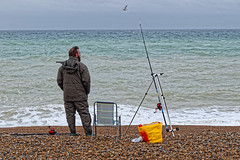 Patience (Croydon Clicker) Tags: beach shingle sea ocean water sky cloud tackle rod tripod line bag chair seat man angler fisherman fishing seaford sussex eastsussex horizon wave blue