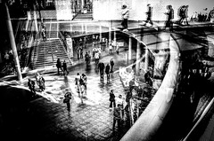 sometimes people just fall (Gerrit-Jan Visser) Tags: amsterdam blackandwhite bnw fall people stairs reflections mood glass walking museum numb hall ricoh gr2
