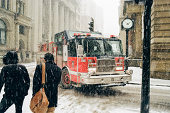 Old Montreal blizzard (haikos) Tags: biogont235 zm reportage kodakgold200 leicam4 montreal fireengine people zeiss blizzard film 35mm winter city streetphotography street