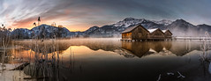 Sunrise at Kochelsee (K.H.Reichert [ not explored ]) Tags: schnee bootshaus morgennebel sunrise steg see reflection berge bayern alpen dawn zwielicht nebel reflexion morningfog natur eis steeg wasser twilight spiegelung sonnenaufgang fog jetty frozen gefroren ice