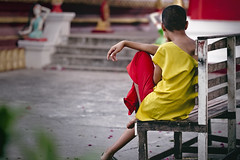 Laotion Monk (toastal) Tags: laos luangprabang backside bench boy monk sitting vat wat happyplanet asiafavorites