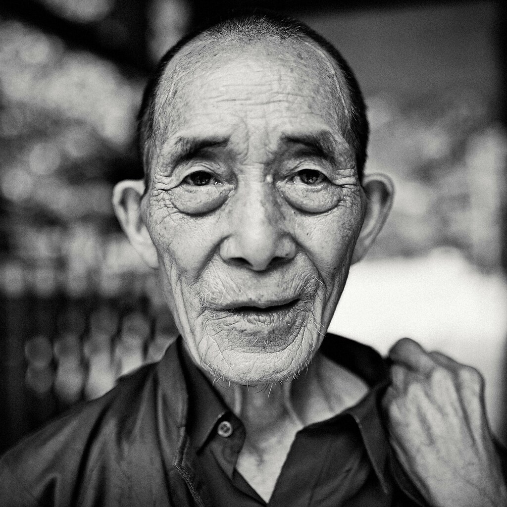 A headshot of old man in guizhou square snowpine tags street streetphotography