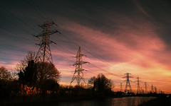 Power Supply (balb_kubrox) Tags: sun rise electricity pylons canal water sky cloud wire