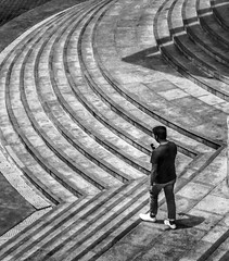 Texting descending stairs (FotoGrazio) Tags: travelphotography fotograzio texting grain noise solo leadinglines monochrome waynegrazio streetphotography design photomanipulation cellphoneuse pattern waynesgrazio streetscene street highangle one philippines man phototoart steps walking gritty descend curves filipino harzardous whiteshoes waynestevengrazio blackandwhite notpayingattention cellphonehazard