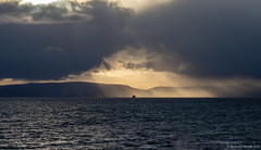 sunshine and rain (Rourkeor) Tags: arran ayrshire caledonianmacbrayne firthofclyde mzuikodigitaled12‑100mm140ispro m43 omdem1markii olympus saltcoats scotland uk clouds ferry lightshadows mft microfourthirds rain reflections ship sky sunrays sunset weather unitedkingdom gb