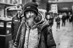 Inquiring Minds (Leanne Boulton) Tags: urban street candid portrait portraiture streetphotography candidstreetphotography candidportrait streetportrait eyecontact candideyecontact streetlife man male face eyes expression mood emotion feeling beard beanie winter tone texture detail character depthoffield bokeh naturallight outdoor light shade city scene human life living humanity society culture lifestyle people canon canon5dmkiii 70mm ef2470mmf28liiusm black white blackwhite bw mono blackandwhite monochrome glasgow scotland uk