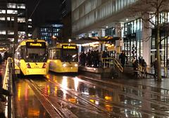 It always rains in Manchester - Metrolink in the rain (mikeyashworth) Tags: manchester metrolink tram rain nightscene glistening stpeterssquare eveningrushhour passengers boarding mikeashworthcollection piccadilly eastdidsbury urbanscene urbantransport publictransport wintersnight cityscape
