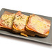 Served baked Toast Sandwiches with ham and cheese on the plate