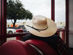 Lemmon Ave. (Zack Huggins) Tags: olympusomdem5markii olympusmzuiko17mmf18 vscofilm pack01 dallastx medicaldistrict discounttire waitingarea cowboy cowboyhat stranger candid street red tireplace americana microfourthirds bokeh dof