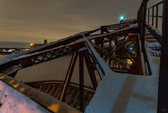 Staggered Stasis. (Nomadic Complacency) Tags: night nightphotography bridge swingbridge railroad snow landscape industrial architecture sony sonyalpha sonya6000 structure structural mississippiriver minnesota saintpaul