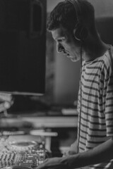 hotchy black and white with stripes (iamthecandleman) Tags: electronic music headphones man scotland flash digital zeiss a7r sony portrait face party basment event dj