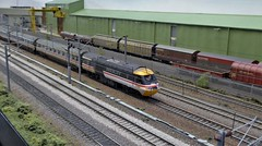 HST Under The Wires at Coppell. (ManOfYorkshire) Tags: coppell wcml westcoast mainline scale model railway layout 176 oogauge britishrail sectorisation 1980s 1990s fiction fictional lincoln exhibition 2019 train hst intercity swallow freight yard unloading factory