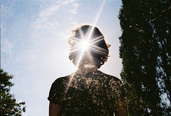 universe reclining in your hair (Lithium Pears) Tags: 35mm 35mmfilm doubleexposure colournegativefilm lomographycn100 lensflare starfilter sunlight summer sky countryside outdoors france canoneos300v canonef50mm