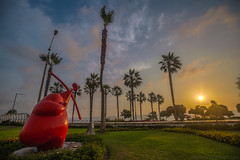 Cupid (Andrea Gambadoro) Tags: yellow cupid lima arrow love photo photography photographer hdr high dynamic range sky clouds city view sunset colour red cityscape