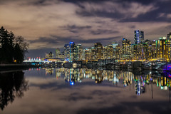 Harbour Reflections (lsoaadi) Tags: blue night harbour cityscape boats buildings reflections trees city highrise beach park glow clouds marina water ocean sea downtown lights residential condos canadaplace