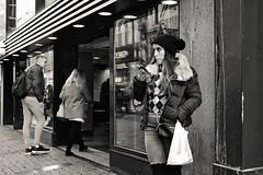 Street scene Kalverstraat , Amsterdam. (Mr.White@66) Tags: monochrome amsterdam blackandwhite biancoenero noiretblanc street candid girl streetphotography schwarzundweis