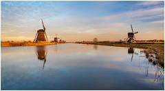 Golden hour at Kinderdijk (Rob Schop) Tags: kinderdijk goldenhour windmill reflection clouds unesco zuidholland alblasserdam color sonya6000 pola hoyaprofilters samyang12mmf20 f8