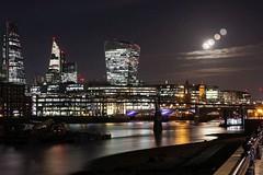 Super Snow moon over London skyline on a cloudy night (glosszoom) Tags: snowmoon super moon supermoon supersnowmoon london england glosszoom 2019 cityoflondon londonthamesriver londonwalkietalkiebuilding skyscraper londonskyscraper lighttrails
