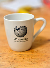 Wikipedia Coffee Cup in front of Computer (josve05a_at_Wikimedia) Tags: white symbol graphic business company table computer cup online information mug website media nobody coffeecup logo encyclopedia wikipedia