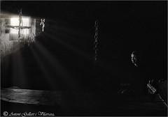 Somnis de llibertat.  (Model: Sandra - Cat.)  (Gelida - Catalunya). (Antoni G.V.) Tags: nikon d800 antoni gallart gelida catalunya cataluña catalonia modelsandra sandra lightrays ratjosllum rayosluz penumbra gloom chain cadena ventana finestra windows liberty libertd llibertat premi premio award dreams somnis sueños interior inside abandonedhouse casaabandonada ombres sombras shadows backlighting contraluz contrallum