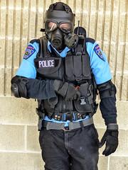 Raccoon Police Officer - Caleb Dwayne Tucker (J Wells S) Tags: raccoonpoliceofficer horrorhoundweekend gasmask costume cosplay vest gloves sharonvilleconventioncenter sharonville cincinnati ohio dressup calebdwaynetucker actor