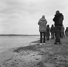 People Watching Dolphins, Chanonry Point, May 2016 (Mano Green) Tags: people watching dolphins sea wildlife nature beauly firth black isle scotland chanonry point uk may spring 2016 shore coast beach water canon eos 300 70300mm lens ilford hp5 medium format film