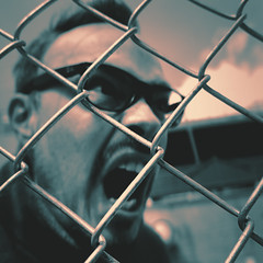 day 98 (Randomographer) Tags: project365 selfportrait self human man confused yell fence chain link metal chainlink wiremesh zigzag pattern diamond weaving wire galvanized face expression glasses 98 365 2019