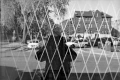 untitled (kaumpphoto) Tags: mamiya nc1000s kodak tmax 3200 street urban city reflection minneapolis pattern diamond geometric car buildling window glass