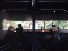 A couple and a guy (malisaaptherev) Tags: strangers candidphoto candid ambience stareatwindow boxroom darkroom arboreacafe interior aguy acouple