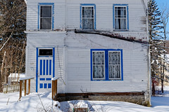 Guest House (fotofish64) Tags: house guesthouse weatherbeaten window door peelingpaint white tourist sharonsprings schohariecounty village capitalregion newyork color blue bluetrim winter snow outdoor pentax pentaxart kmount k70 hdpentaxda1685mmlens route20