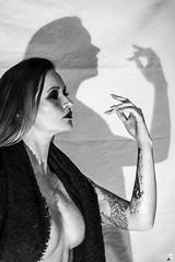 MelKristinCreep-8 (Onelog Photography) Tags: dark creepy blackandwhite smoke vintage spotlight shadow studio strobe grain latex dominatrix booty boobs cleavage wolf contrast