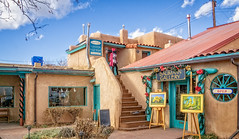 A gallery and a store (Tigra K) Tags: taos newmexico unitedstatesofamerica us 2018 architecture blue court dress funny landscape object painting sign stairs store town usa window art