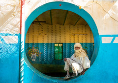Sudanese boy resting inside a circular window in a restaurant, Khartoum State, Khartoum, Sudan (Eric Lafforgue) Tags: adultsonly africa architecture blue buildingfeature circle circularwindow colorimage culture curve day fulllength horizontal khartoum lookingatcamera men onemanonly oneperson photography sudan sudan180012 traditionalclothing traveldestinations wallbuildingfeature window khartoumstate