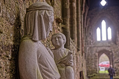Sculpture (Geoff Henson) Tags: statue sculpture religious mary jesus pigeon dove abbey church medieval ruin remains wall window person light tinternabbey monmouthshire wales