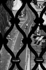 [ Trame e percorsi - Plots and paths ] DSC_0474.R2.jinkoll (jinkoll) Tags: street direction road man people walk walking blackandwhite bnw bw bn above geometry lines lungotevere roma rome through sunny contrast metal grill holes