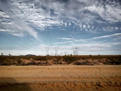 (Stationarytrains) Tags: desert wires telephonelines vast sky endless scenery nature clouds