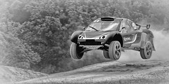 Hold on to your stomach ..... (Gary-West Sussex) Tags: car jump bw speed goodwood fos goodwoodfestivalofspeed goodwoodfos dust