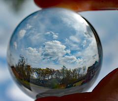 Saturday Afternoon Through A Lensball. (dccradio) Tags: lumberton nc northcarolina robesoncounty outside outdoor outdoors lensball lensballphotography tensphy sky clouds bluesky march spring springtime nature natural landscape hand finger thumb nikon d40 dslr crystalball glassball glass circle round saturday weekend saturdayafternoon afternoon goodafternoon dumpster trashbin redtruck truck pickup pickuptruck tree trees woods wooded forest parking parkinglot paved pavement