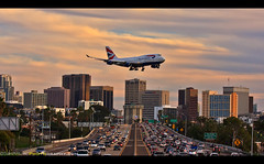 The Queen of the Skies on final approach into San Diego (Sam Antonio Photography) Tags: boeing 747 fourengine freeway highway traffic cityscape sky california travel tourism airplane airport landing transportation aviation jet transport sunset sandiego plane vacation destination lindberghfield airliner speed pilot air fly copyspace aviationbackgrounds flight passengerjet flying airtrafficcontrol approach commercialairliner background commercial commercialaviation technology sandiegocalifornia landscape downtown usa queenoftheskies