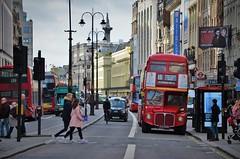 Down the Strand.... (stavioni) Tags: london strand street rm rm1933 lt transport double decker bus black cab taxi cyclist nelsons column people pedestrian theatre